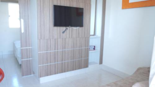 A television and/or entertainment center at Apartamento Via Caldas L'Acqua II