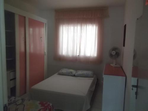 A bed or beds in a room at Apartamento de 2 quartos em Porto Seguro
