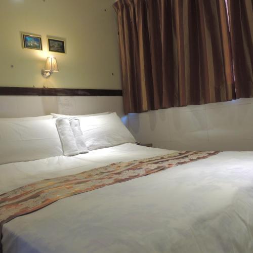 호텔 관 저우 객실 침대