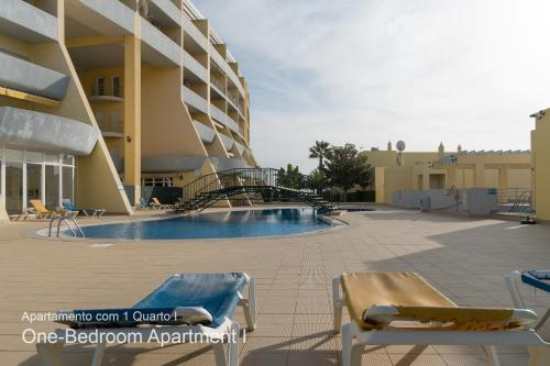 The swimming pool at or near Akisol Lagos Mar