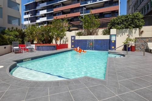 The swimming pool at or near West End Central Apartments