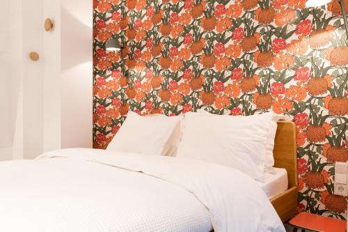 Cama o camas de una habitación en Kith & Kin Boutique Apartments