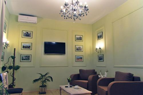 A television and/or entertainment center at Classic Apartment on Zhukovskoho