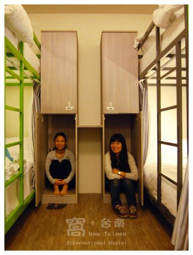 A bunk bed or bunk beds in a room at Wow Tainan Hostel