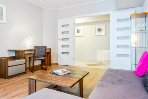 A seating area at Warm Street Apartment - Peace and Comfort