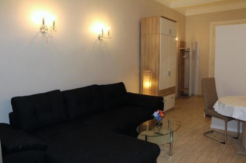 A seating area at Stars Berlin Apartments Essener Straße