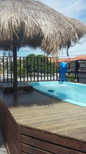 Het zwembad bij of vlak bij Suites Tropicana