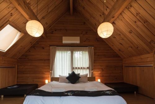 A bed or beds in a room at Balls Deep Inn Villas
