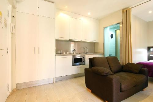 A kitchen or kitchenette at ClassBedroom Beach Barcelona Apartments