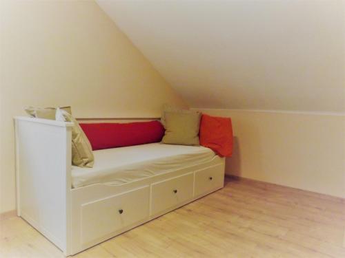 Ein Bett oder Betten in einem Zimmer der Unterkunft Feriendomizil am Rheinbogen