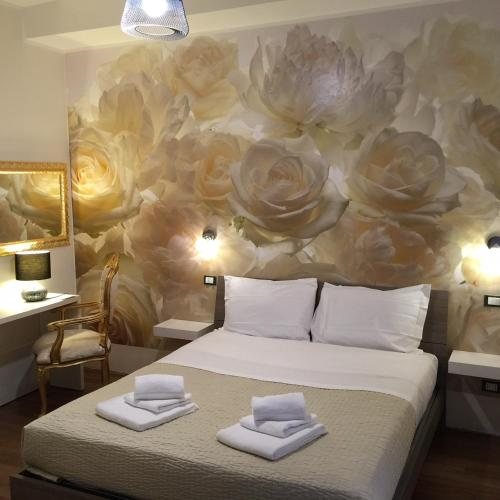 A bed or beds in a room at B&B Rigoletto