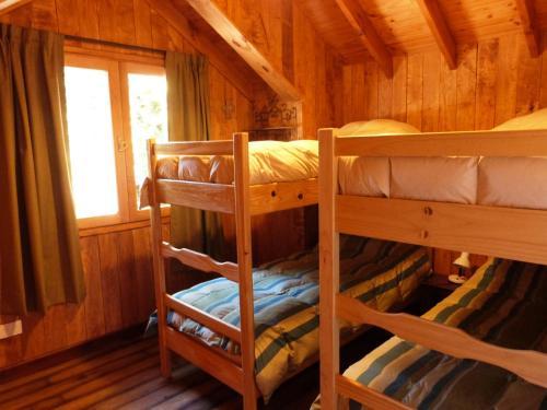 Una cama o camas cuchetas en una habitación  de Departamento Coronel Diaz