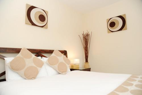 A bed or beds in a room at Century Wharf Serviced Apartments