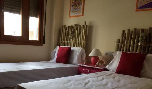 Apartamento Marina Esuri房間的床