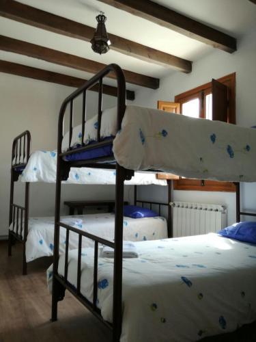 A bunk bed or bunk beds in a room at Los Canarios