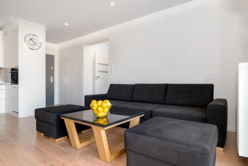 A seating area at Apartament Bóżnicza Centrum