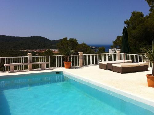 The swimming pool at or near Beautiful Villa in Cala Tarida with Swimming Pool