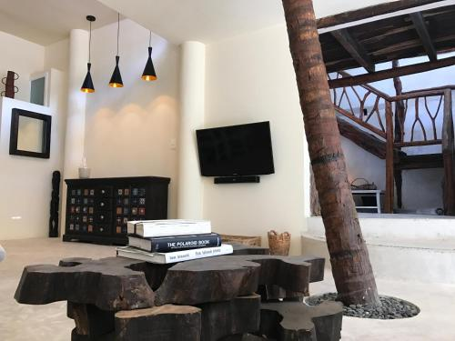 A television and/or entertainment center at Luna Maya House