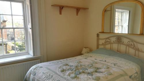 A bed or beds in a room at Teesdale Rooms