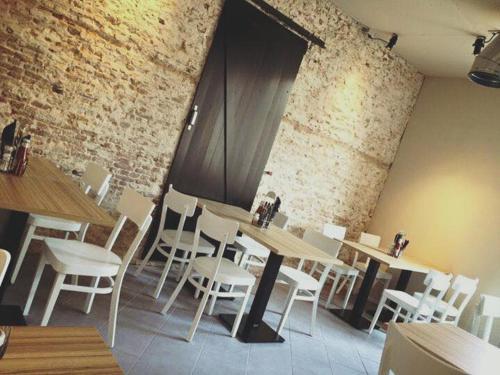 Een restaurant of ander eetgelegenheid bij Studio's de Domburger