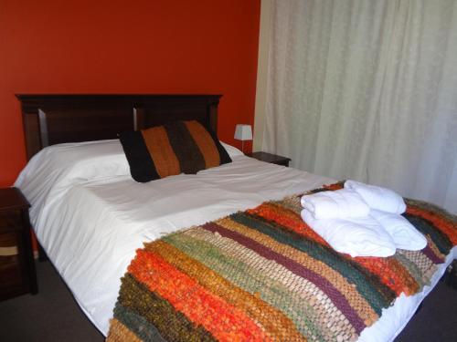 Cama o camas de una habitación en Cabañas del Puerto