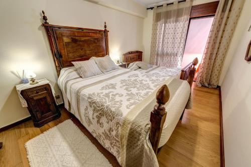 Katil atau katil-katil dalam bilik di Bragança Apartments