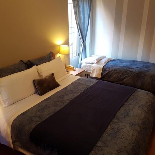 Letto o letti in una camera di Hotel Moniga