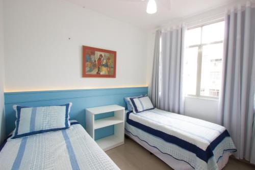 A bed or beds in a room at Novo - No Coração De Copacabana