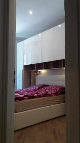 Cama ou camas em um quarto em Nice Livings Lazzaroni