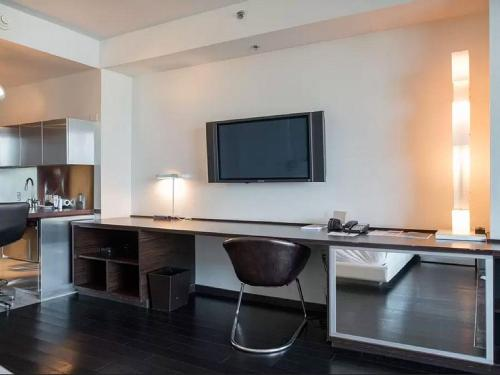A television and/or entertainment center at Palms Place 50th floor with balcony & strip view