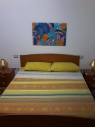 Letto o letti in una camera di B&B Sea And Sardinia
