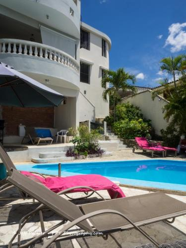 The swimming pool at or near Chambres d´hotes La Romana