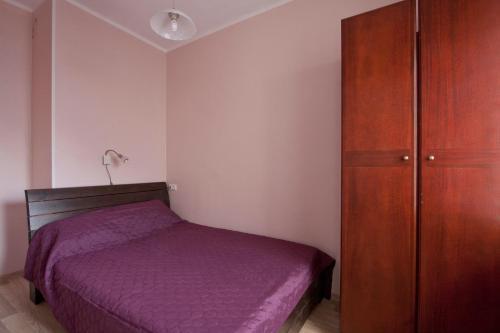 Vuode tai vuoteita majoituspaikassa Aedvilja Apartment