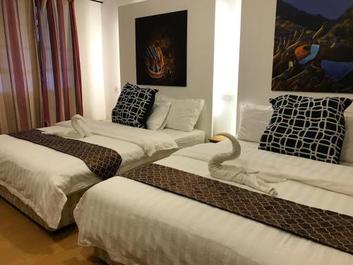 Cama o camas de una habitación en The Barat Perhentian