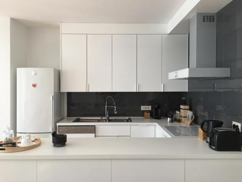 A kitchen or kitchenette at K Residence Zadar apartment