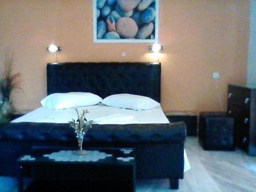 A bed or beds in a room at Noula Studio