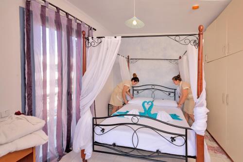 12 Islands Villas tesisinde bir odada yatak veya yataklar