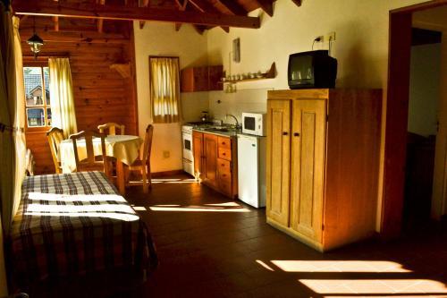 Una cocina o kitchenette en Apart Hotel del Chapelco