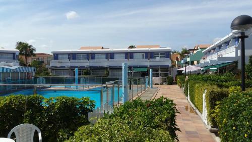 Uitzicht op het zwembad bij Bungalow en Maspalomas 19 of in de buurt