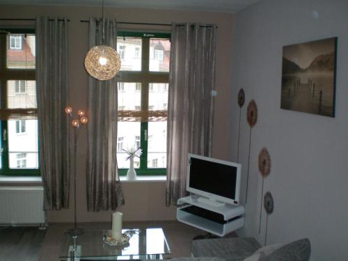 A television and/or entertainment center at Apartment Thomasius