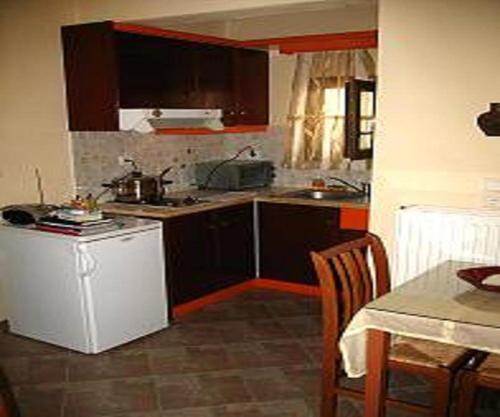 A kitchen or kitchenette at Pension Stella