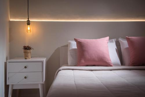 A bed or beds in a room at Veneziano Boutique Hotel