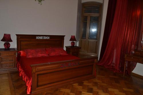 Кровать или кровати в номере Апартаменты Арма