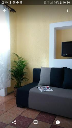 A seating area at Guesthouse Lora