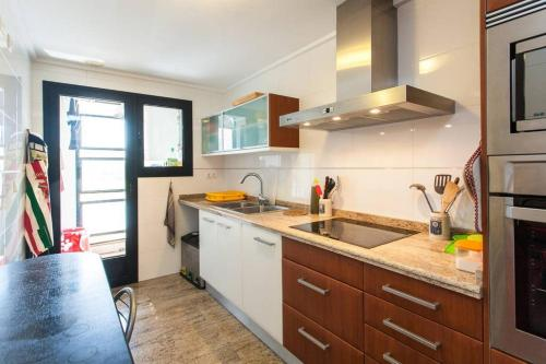 Kuchyň nebo kuchyňský kout v ubytování Biopark View Apartment
