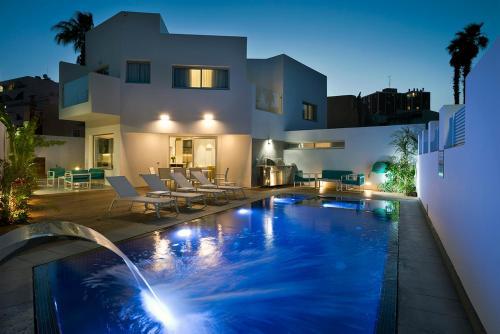 The swimming pool at or near Villa Gardenya