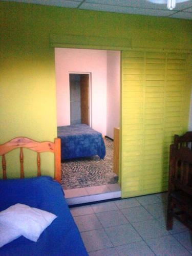 A bed or beds in a room at Terralta Mini Cabana