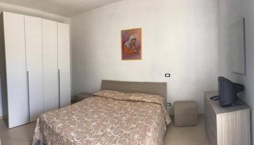 Letto o letti in una camera di Appartamenti Le Buganville