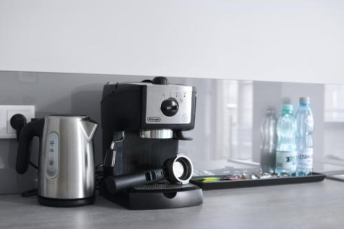 Coffee and tea-making facilities at Blue Birds Apartment