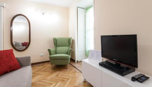 A television and/or entertainment center at Italianway-Lazzaro Palazzi
